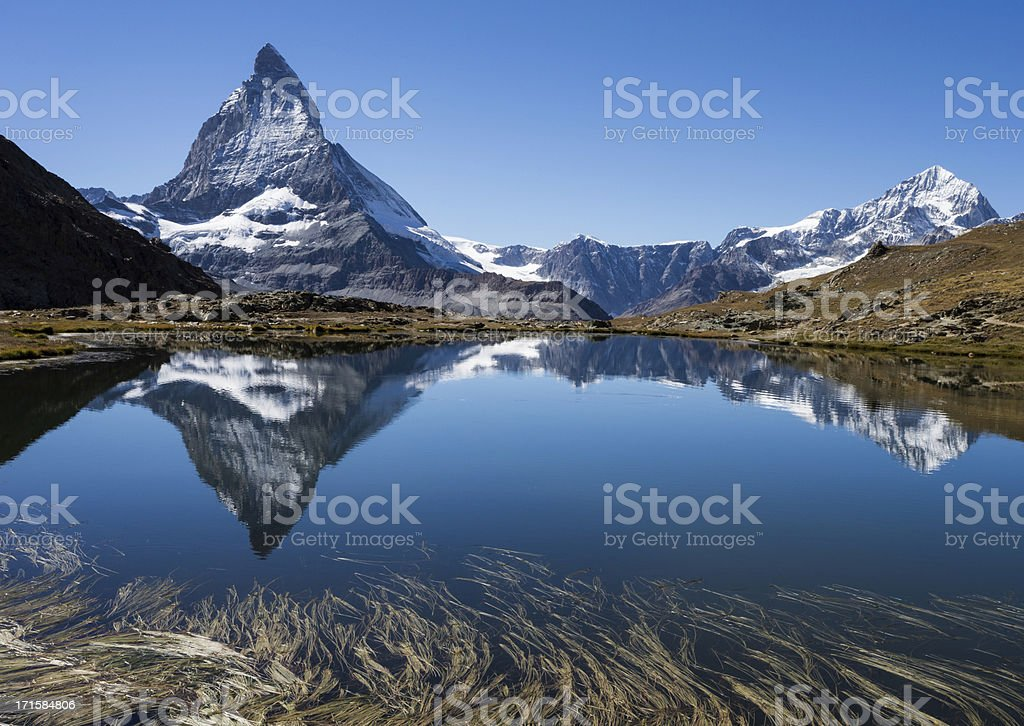 Panorama of beautiful Matterhorn and reflection in a lake stock photo