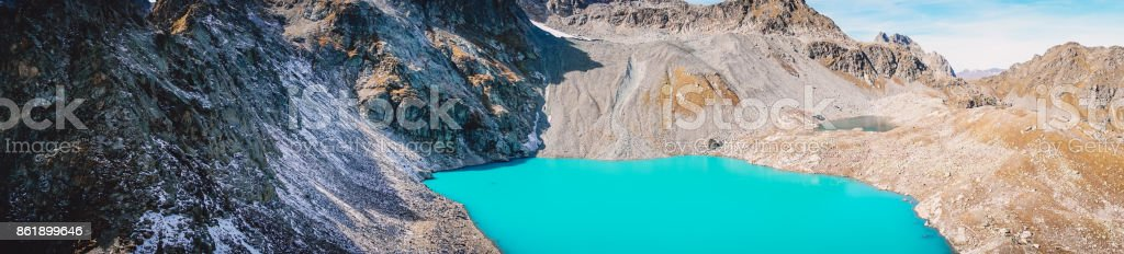 Panorama of beautiful mountain lake with turquoise water and rocky mountains stock photo