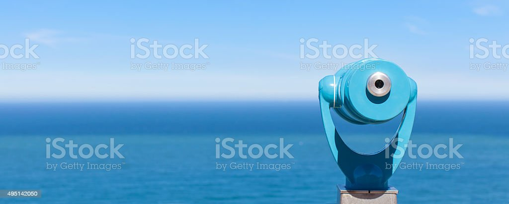 panorama of binoculars and ocean stock photo