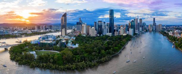Panorama of Brisbane skyline at sunset stock photo