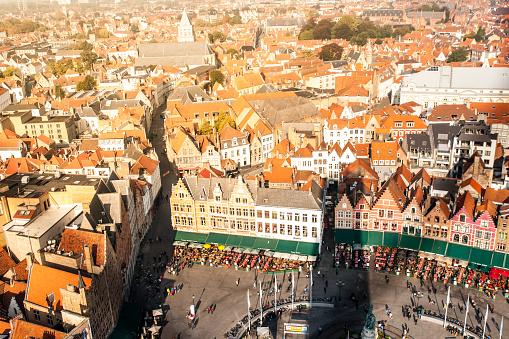 Panorama of Bruges, aka Brugge. View from Belfort tower. Orange rooftops around Market Square, Belgium