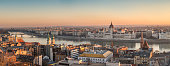 Wide Panorama of Budapest with Hungarian Parliament and Danube River at Sunrise