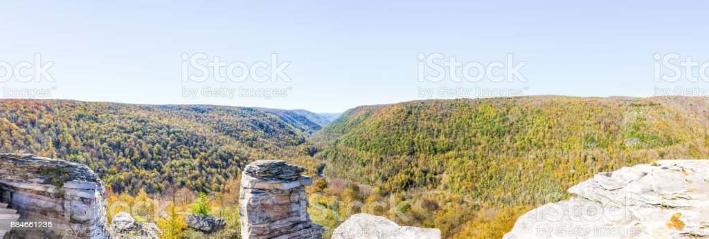 Panorama of canaan valley mountains in Blackwater falls state park in West Virginia during colorful autumn fall season with yellow foliage on trees, rock cliff at Lindy Point stock photo