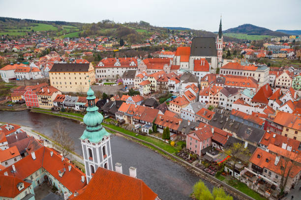 Panorama of Cesky Krumlov with castle tower. Cloudy spring weather. UNESCO World Heritage Site stock photo
