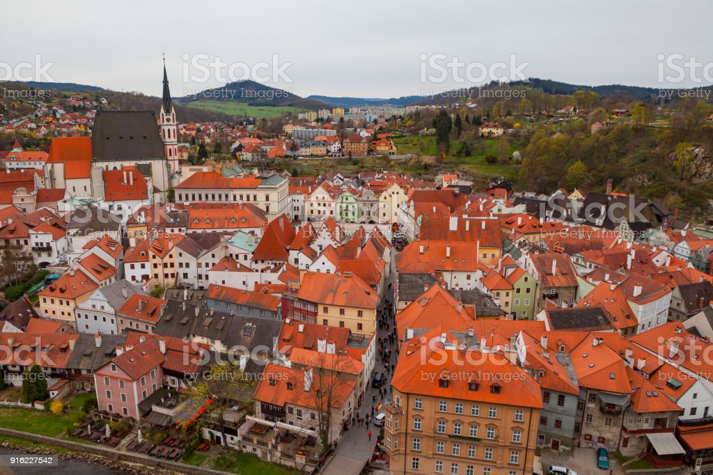 Panorama of Cesky Krumlov with old red roofs. Cloudy spring weather. UNESCO World Heritage Site stock photo