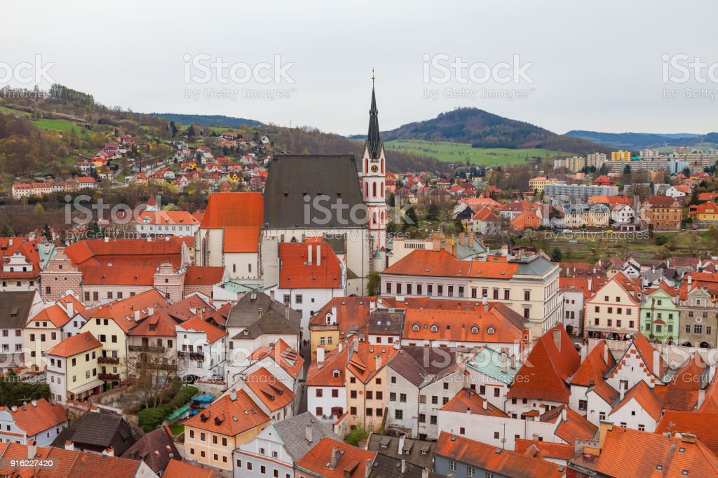 Panorama of Cesky Krumlov with Saint Vitus Church. Cloudy spring weather. UNESCO World Heritage Site stock photo