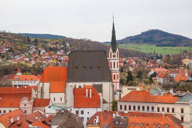 Panorama of Cesky Krumlov with Saint Vitus Church. Cloudy spring weather. UNESCO World Heritage Site stock photo