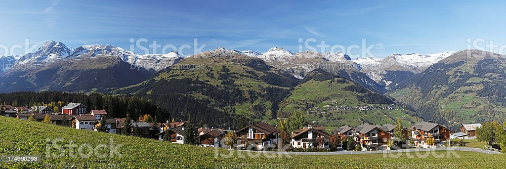 Panorama of Chalets and Swiss Alps stock photo