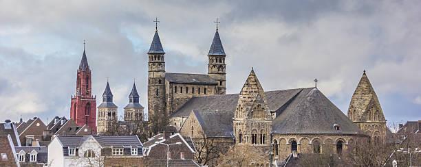 panorama of church towers in maastricht - maastricht stockfoto's en -beelden