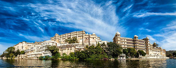 Panorama of City Palace. Udaipur, India India luxury tourism concept background - panorama of Udaipur City Palace from Lake Pichola. Udaipur, India udaipur stock pictures, royalty-free photos & images