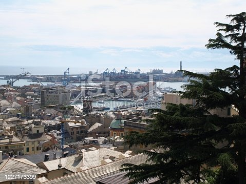 Panorama of container and passenger terminals in seaport of Genoa on Mediterranean Sea, Italy.