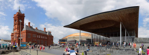 Panorama of crowds of people visiting Eisteddfod week in Cardiff Bay 2018 Cardiff, Cardiff Bay, Wales - August 4th 2018. Panorama of crowds of people visiting Eisteddfod week in Cardiff Bay 2018 welsh culture stock pictures, royalty-free photos & images