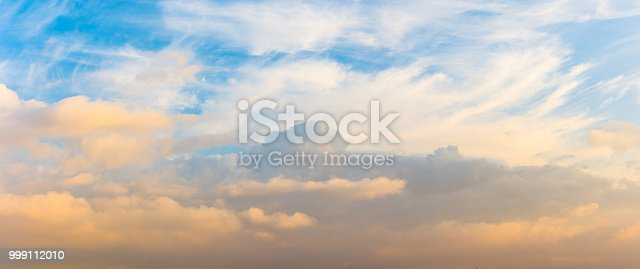 istock Panorama of cumulus clouds at sunset with gradient sky. 999112010