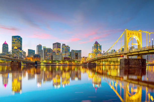 Panorama of downtown Pittsburgh at twilight Panorama of downtown Pittsburgh skyline at twilight pittsburgh stock pictures, royalty-free photos & images