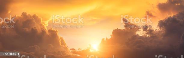 Photo of Panorama of dramatic orange clouds in the evening sky