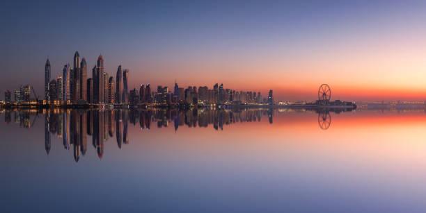 Panorama of Dubai Marina skyline at sunset stock photo