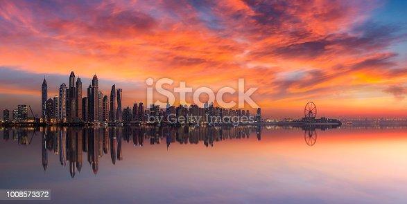istock Panorama of Dubai Marina skyline at sunset with a beautiful dramatic sky 1008573372