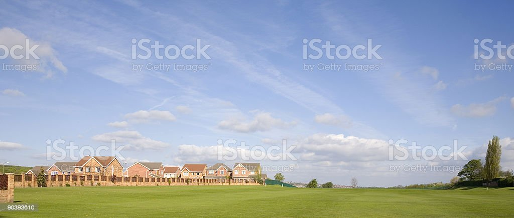Panorama of English Houses Beside a Cricket Field royalty-free stock photo