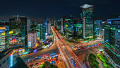 Panorama aerial view of famous crowded Crossing at Downtown Gangnam Station at Night with motion blured traffic lights and surrounding modern skyscrapers. Gangnam District, Seoul, South Korea, Asia.