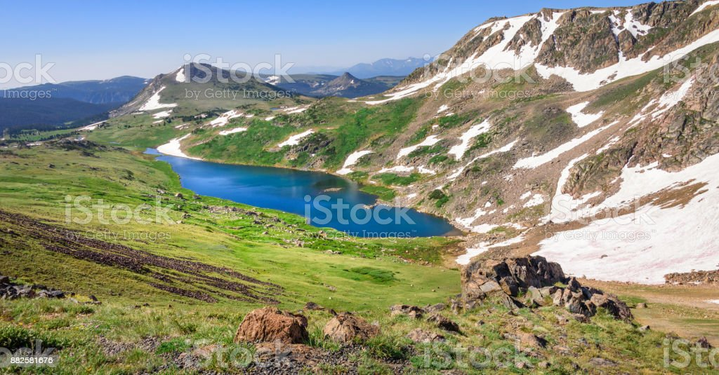 Panorama of Gardner Lake, Beartooth Pass. Peaks of Beartooth Mountains, Shoshone National Forest, Wyoming, USA. stock photo