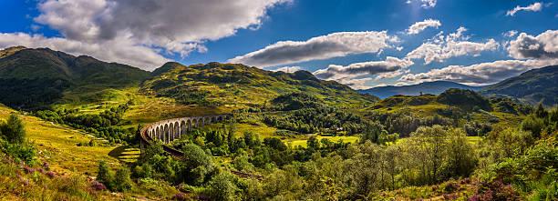 Panorama of Glenfinnan Railway Viaduct in Scotland and surrounding mountains stock photo