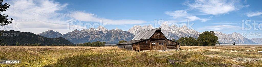 Panorama of Grand Tetons with Mormon Barn royalty-free stock photo