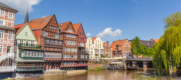 Panorama of half-timbered houses at the historic harbor of Luneburg Luneburg, Germany - May 21, 2017: Panorama of half-timbered houses at the historic harbor of Luneburg lüneburg stock pictures, royalty-free photos & images