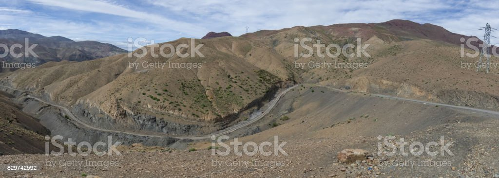 Panorama of High Atlas mountain range and serpentine road from on of pass, Morocco, Africa stock photo