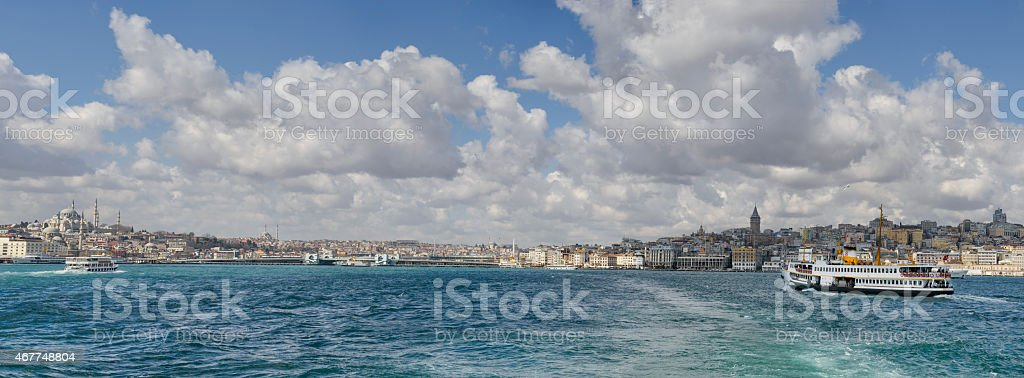 Panorama of Istanbul seen from the Bosphorus with ferries stock photo