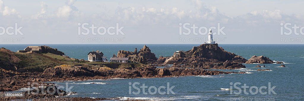 Panorama Of Jersey Coastline And Corbière Lighthouse stock photo