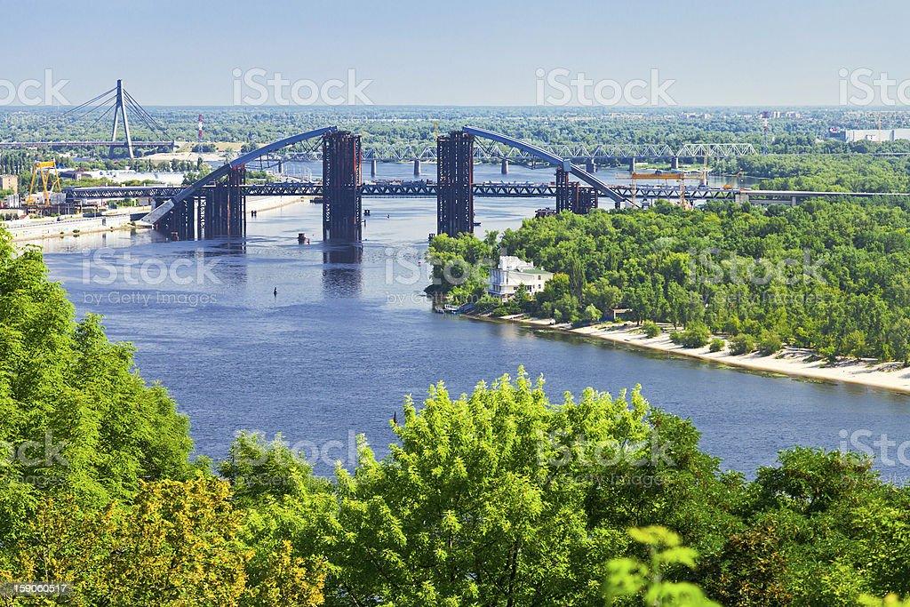 panorama of Kiev with Podilsko-Voskresenskyi Bridge on Dnieper River...