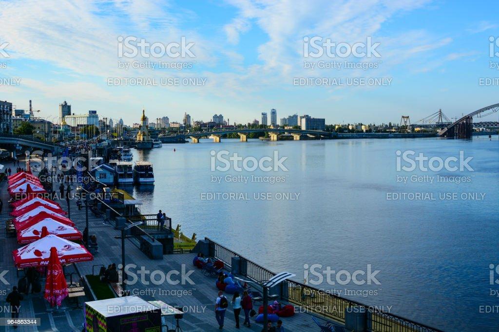 Panorama of Kyiv, Ukraine. Dnipro river, Podilsko-Voskresensky Bridge and Kyiv River Port waterfront royalty-free stock photo