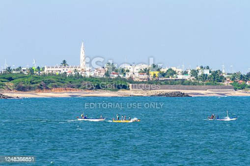 istock Panorama of Laccadive Sea, fishing boats and Kanyakumari town on the background of mountains at the southernmost point of India 1248366851