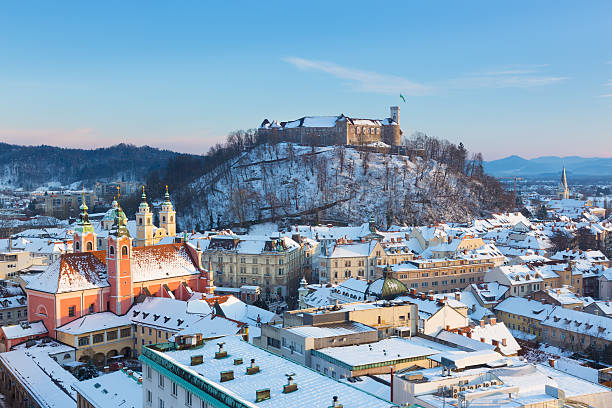 Panorama of Ljubljana in winter. Slovenia, Europe. Panoramic view of Ljubljana, capital of Slovenia. Roofs covered in snow in winter time. ljubljana castle stock pictures, royalty-free photos & images