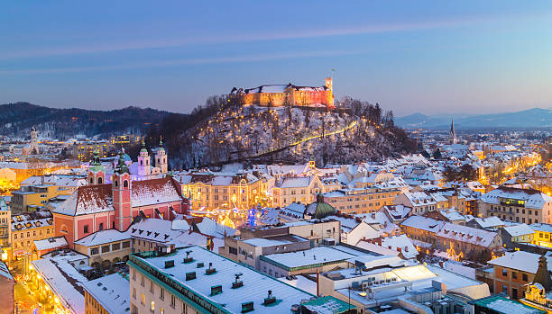 Panorama of Ljubljana in winter. Slovenia, Europe. Aerial panoramic view of Ljubljana decorated for Christmas holidays. Roofs covered in snow in winter time. Slovenia, Europe. ljubljana castle stock pictures, royalty-free photos & images