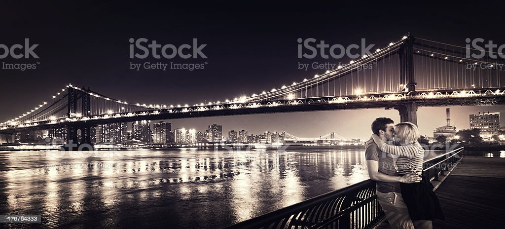 Panorama of loving couple kissing in New York City royalty-free stock photo