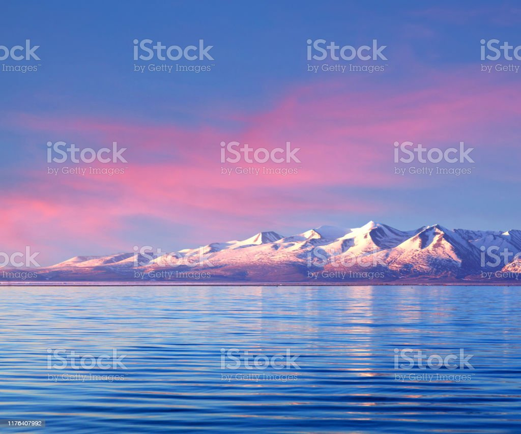 Panorama of Manasarovar lake, Western Tibet, China Panorama of Manasarovar lake at sunrise in Ngari, Western Tibet, China. According to the Hindu religion, the lake was first created in the mind of the Lord Brahma after which it manifested on Earth Asia Stock Photo
