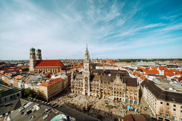 Panorama of Marienplatz square with New Town Hall and Frauenkirche (Cathedral of Our Lady). stock photo