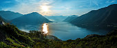 Panorama of Mediterranean Sea surrounded by mountains at colorful sunset. Montenegro