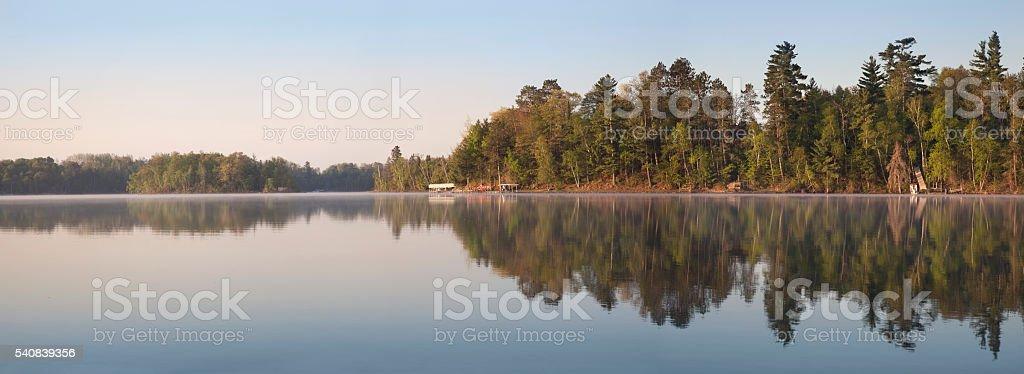 Panorama of Minnesota Lakeshore on Calm Morning During Spring stock photo