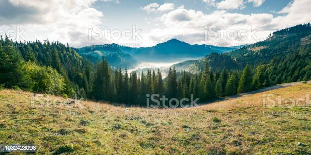 Photo of panorama of mountain and foggy valley