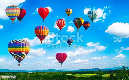 istock Panorama of mountain with hot air balloons on morning at Thailand. 996184508