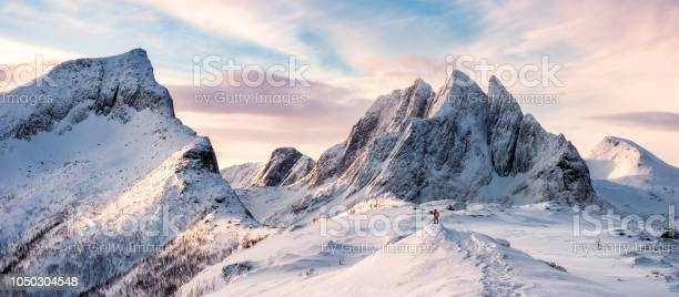 Panorama of mountaineer standing on top of snowy mountain range picture id1050304548?b=1&k=6&m=1050304548&s=612x612&h=ea9yz2ms2mdqbxjgbnp njtbilw1w7m3x9ekp ah1bk=
