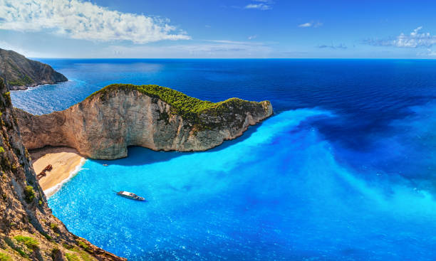 Panorama of Navagio Beach (Shipwreck Beach), Zakynthos island, Greece. Aerial view of Navagio Beach (Shipwreck Beach), Zakynthos island, Greece. saturated color stock pictures, royalty-free photos & images