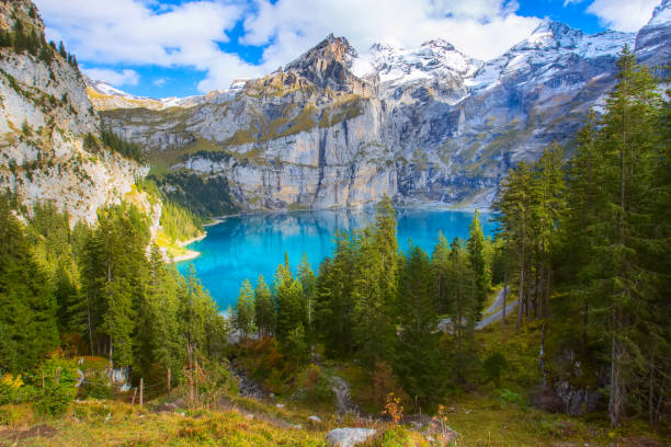 Panorama of Oeschinensee lake and Alps, Switzerland. stock photo