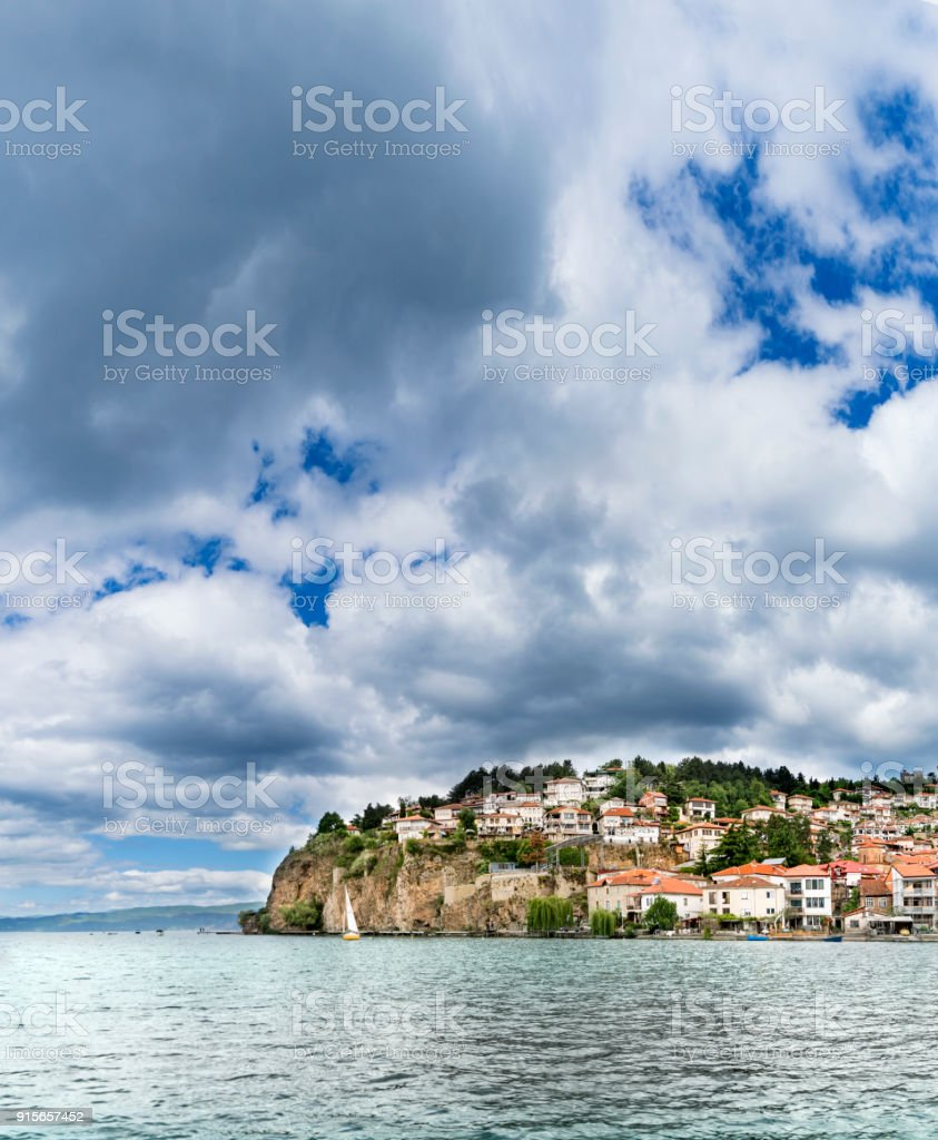 Panorama of Ohrid city and lake Ohrid of a cloudy spring day, vertical stock photo