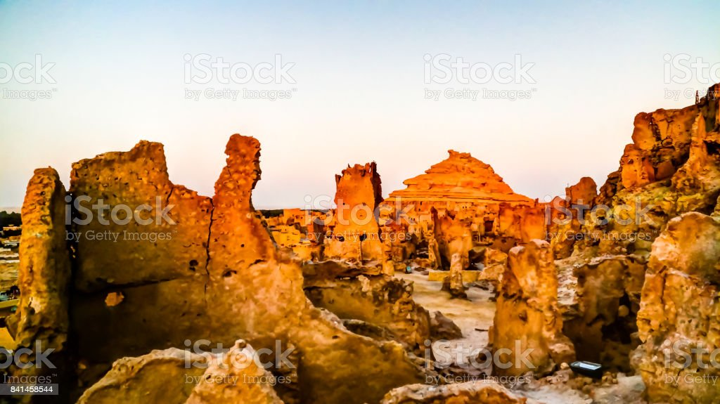 Panorama of old city Shali and mountain Dakrour in Siwa oasis at sunrise , Egypt stock photo