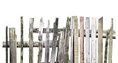 istock Panorama of old wooden fence of different boards isolated on white background. Broken fence 877122424