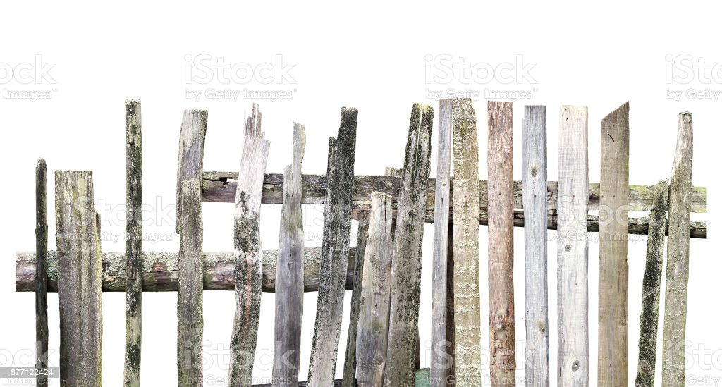 Panorama of old wooden fence of different boards isolated on white background. Broken fence stock photo