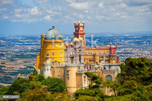 Sintra, Portugal - July 5, 2012: Panorama of Pena National Palace above Sintra town at a summer day. Visible some unrecognizable people in the rooftops